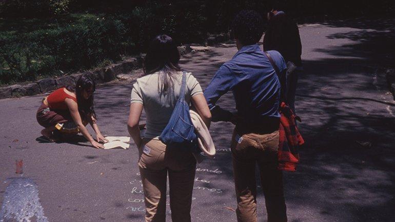 Cecilia Vicuña. Vaso de leche derramado bajo el cielo azul. Action, 1979 Photographies of the collaboration in Bogota as part of the project C.A.D.A. Courtesy: Gallery England & Co