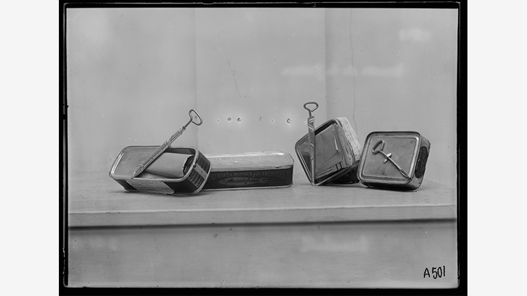 George E. Marshall, Method used by Germans to disseminate propaganda. Reading material was inserted in sardine tins and sent to different countries. These tins are in the Musée de la Guerre, Paris, 1919. Library of Congress, Prints and Photographs Division
